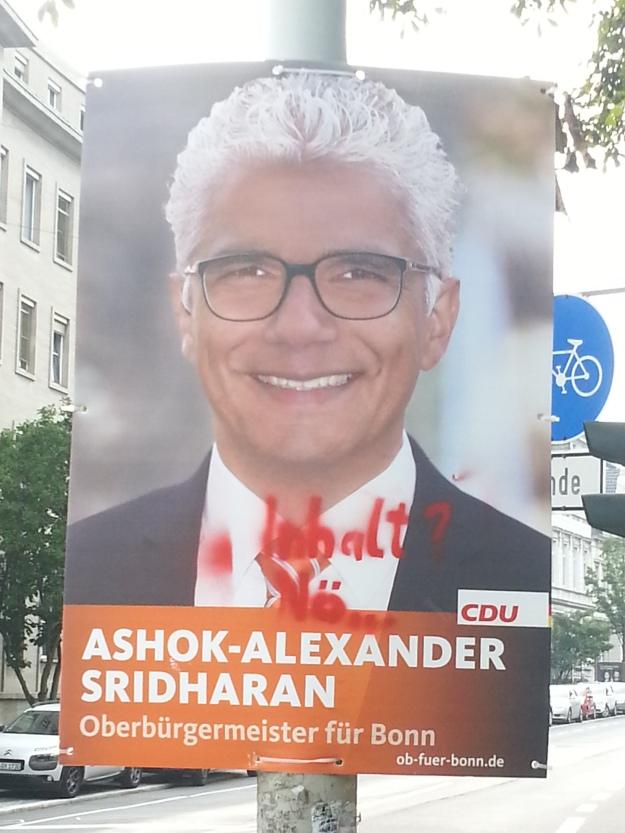 Foto eines veränderten Wahlplakates von Ashok Sridharan, CDU, zur OB-Wahl 2015