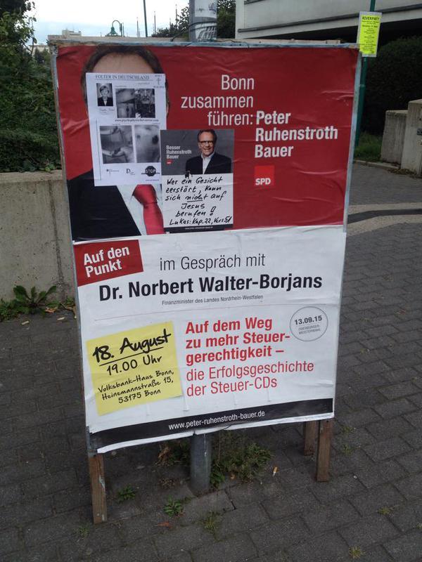 Foto eines veränderten Wahlplakates von Peter Ruhenstroth-Bauer, SPD, zur OB-Wahl 2015, auf dem der Kandidat auf die Veränderung wieder reagiert hat