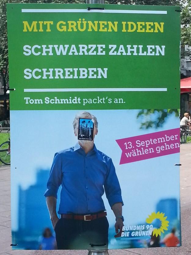 Foto eines veränderten Wahlplakates von Tom Schmidt zur OB-Wahl 2015