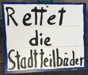 Foto eines selbstgemalten Schildes eines unbekannten Künstlers zum Bürgerentscheid
