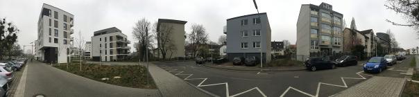 Foto des Bauvorhabens Südstadtgärten in Bonn-Kessenich, Panoramaaufnahme von der Eingangssituation in das Quartier mit umliegenden Gebäuden